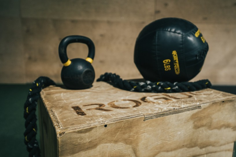 This image shows a gym with a kettlebell and a ball like you'd use for your workouts.
